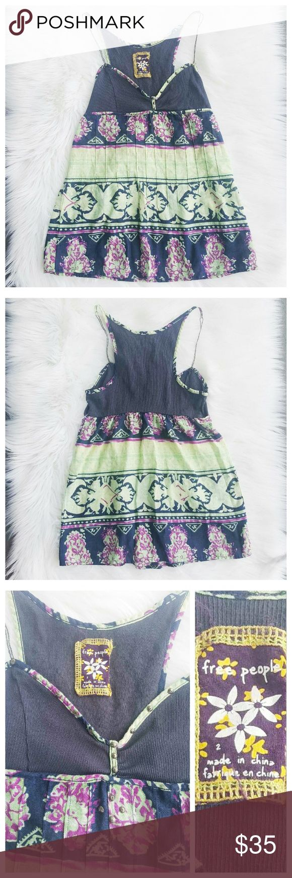 """Anthropologie Free People colorful printed top ~Bust: 28""""-31"""" ~Length: 23"""" ~Stretchy: Yes, in the just area ~Material: 100% Cotton  ~Condition: Excellent like brand Bew ~Care: Hand wash Cold  ~Size: 2  This top was sold in the store Anthropologie. Anthropologie Tops Tank Tops"""