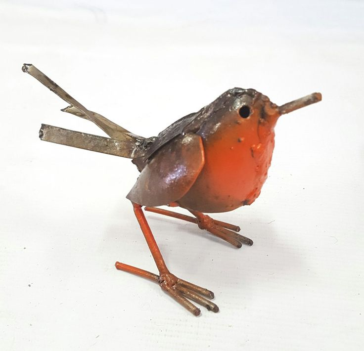 These animated little Robins are handcrafted in Cape Town by Zimbabwean artist, Arnold. Created with scrap metal retrieved from scrapped cars. Each little