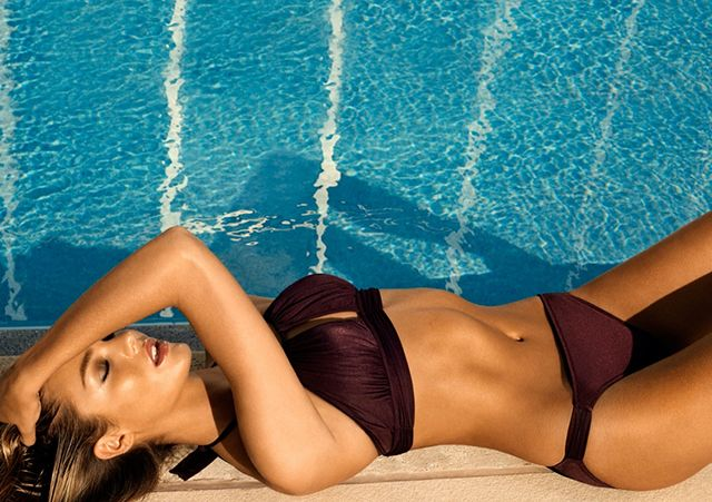 Candice Swanepoel shows perfect body - Candice Swanepoel bikini shoot for Zeki Triko - clear blue skies and sparkling pools.