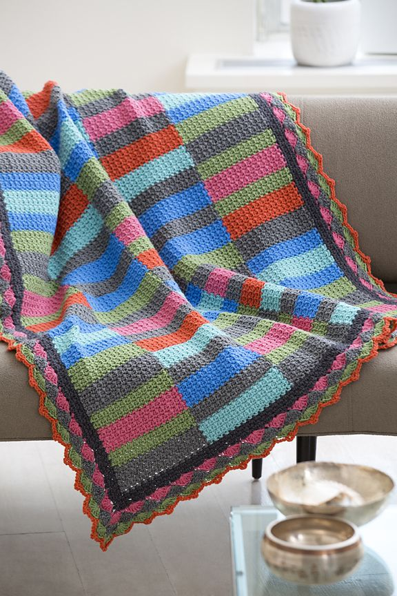 "Bars & Strips Throw, free pattern by Katherine Eng.  Simple to work up using SC & chain stitches, make 5 strips that are then joined together.  56.5"" x 45"", takes 8 skeins RHSS with a 'J' hook.  Would be a good scrap project.  #crochet #afghan #blanket"