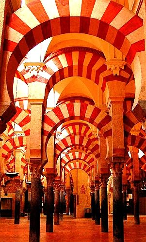 I think this is in Cordoba, Spain.  Was a mosque now a catholic cathedral.  La Mezquita.