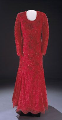 Laura Bush wore this ruby-red gown of crystal-embroidered Chantilly lace over silk georgette to the 2001 inaugural balls. A sketch and description of the dress was released to the press two weeks before the inauguration. The dress was designed by fellow Texan Michael Faircloth. Some reports speculated that Faircloth encouraged the normally conservative Mrs. Bush to choose the brilliant color.Laura Bush, Inauguration Ball, Ball Gowns, Chantilly Lace, Bush Inauguration, Inauguration Gowns, Silk Georgette, Brilliant Colors, Fellows Texans