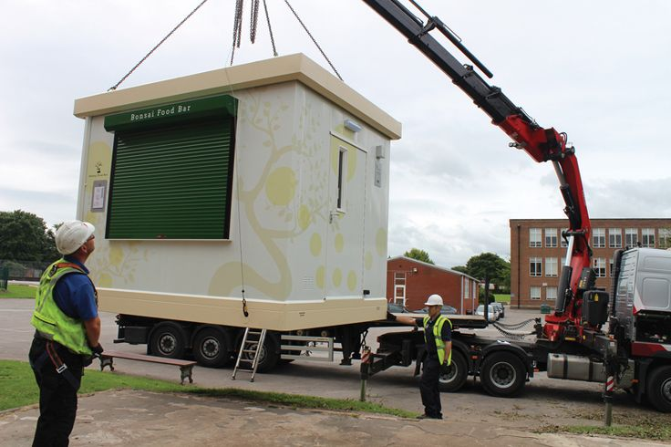 A PKL Food Cube being installed at Tudor Grange Academy