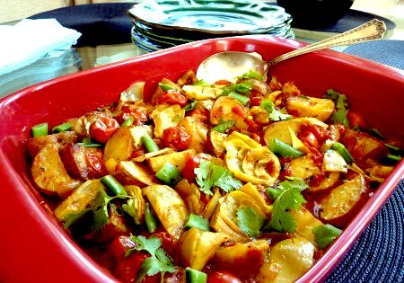 Tagine of Saffron Potatoes, Roasted Cherry Tomatoes, Artichoke Hearts and Sugar Snap Peas #morrocan #recipe