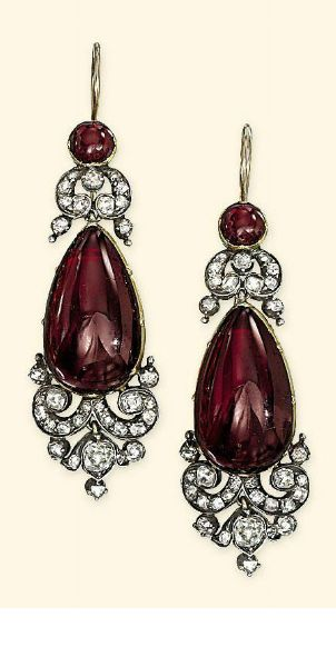 A VICTORIAN GARNET AND DIAMOND DEMI-PARURE  Comprising a brooch with garnet cabochon centre within old-cut diamond cartouche-shaped surround suspending a detachable two-stone garnet and and diamond pendant; ear pendants en suite, together with diamond and garnet suspension loop and chain for necklace conversion, mounted in silver and gold, adapted, circa 1860, pendant/brooch 7.0cm long, ear pendants 5.3cm long