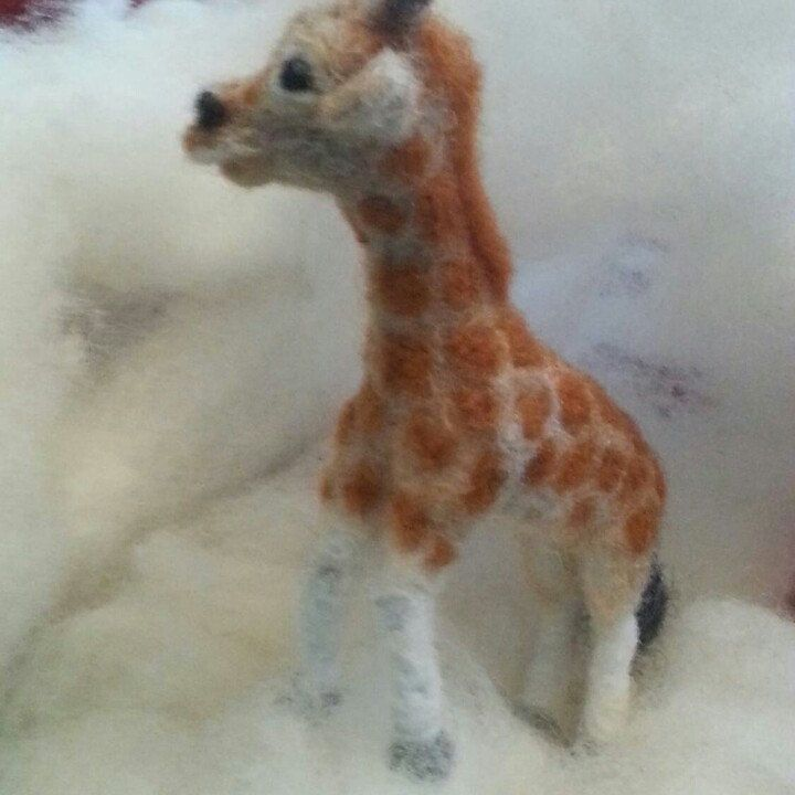 """Miniature giraffe 2-3 inch, just before getting ready to be shipped. """"Am I really made of this fluffy stuff?"""""""
