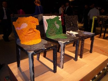 Italian design firm Casamania exhibited a set of chairs and tables that are formed out of recycled clothes set in place with resin and a steel frame. The clothes are sourced from unwanted stock from some of Italy's department stores, although buyers can ask for furniture made from their own discarded clothing for a more personalised touch.