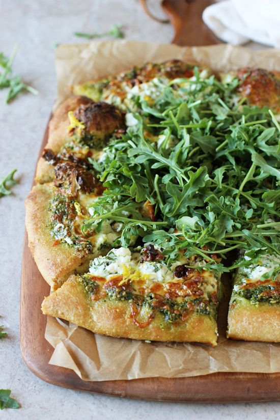 Recipe for arugula pesto pizza. With herbed ricotta, walnuts and lemon ...