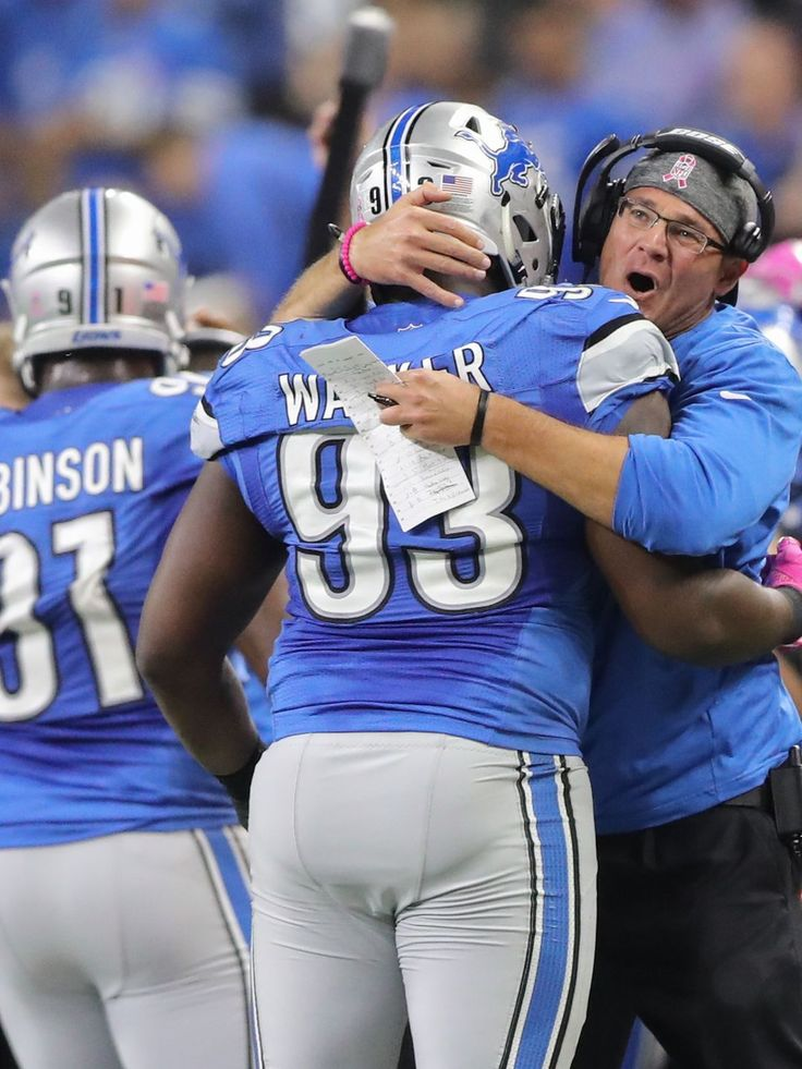 Eagles vs. Lions:  24-23, Lions, October 9, 2016  -       Lions defensive tackle Tyrunn Walker celebrates with defensive line coach Kris Kocurek after recovering an Eagles fumble late in the fourth quarter Sunday, Oct. 9, 2016 at Ford Field in Detroit.  Kirthmon F. Dozier, DFP