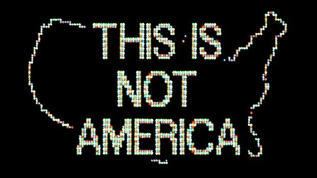 Times Square : reenactment of 1987 intervention 'A Logo for America', by Alfredo Jaar (Guggenheim)