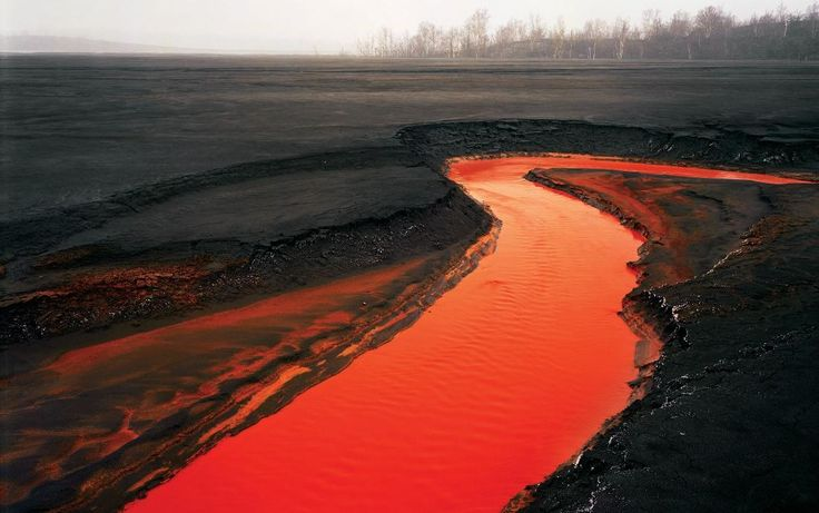Red River in Sudbury, Ontario, Canada.  Iron from a nearby nickel factory makes the water red.