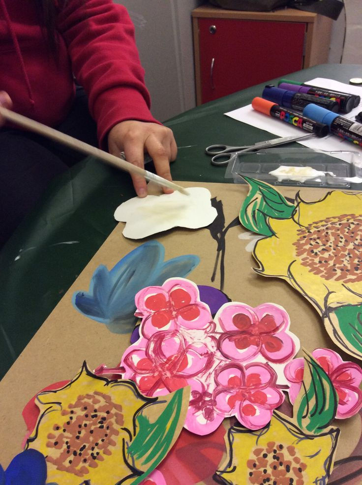 1.3 Explore the properties of available craft materials . Here I am using different card boards and and glues and paints to create flowers for a peice of art.