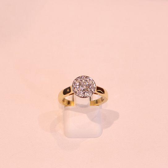 Diamond in gold ring setting