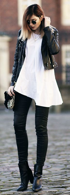 A cropped leather jacket is a great option for every day casual wear. Not only do they look good over standard tees and shirts, but combined with oversized or long tops they can add a whole new dimension to the look. Via Jana Wind.  Jacket/Trousers: Guess, Top: COS, Boots: Sol San. Black And White Looks.