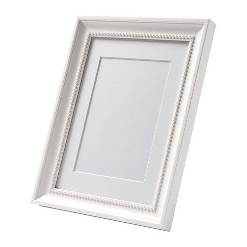 """Ikea """"SÖNDRUM""""  Frame, white  $3.99  The mat enhances the picture and makes framing easy.  For the awesome photos dad gave us for Christmas."""