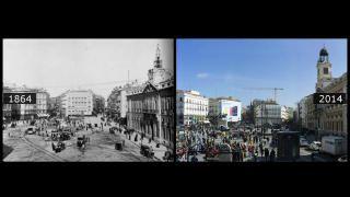 En esta imagen de la Puerta del Sol en 1864, la casa de Correos ya presidía la plaza. La fuente central se trasladaría poco después. El viejo reloj de la sede del Ministerio de Gobernación no funcionaba («Ese reló es el espejo / del gobierno que hay debajo» decía una copla anónima), por lo que se le encargó a José Rodríguez Losada el actual, que necesitó un cambio en la torre para poder albergar la famosa bola. Fue inaugurado el 19 de noviembre de 1866