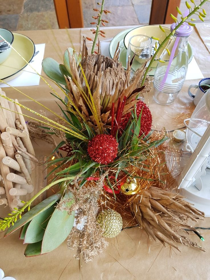 Dried protea, spray painted gold. A South African Christmas