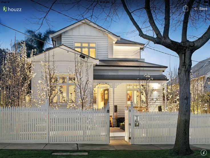 Two storey weatherboard house - articulated front
