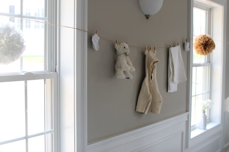 ideas for a Gender Neutral Baby Shower  //  gender neutral outfits on clothes line  //  grey, white, cream, burlap baby shower
