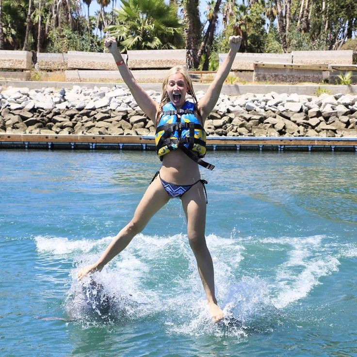 Kristine Leahy riding on the dolphins