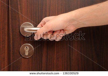stock-photo-door-with-a-hand-on-handle-136330529.jpg (450×319)