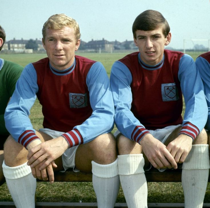 West Ham United captain Bobby Moore with team-mate Martin Peters, August 1965