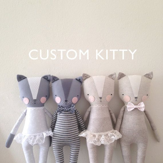 Luckyjuju dolls are handmade from new and vintage fabrics, felt, lace and polyfill stuffing. The face is hand embroidered with floss. Each doll is
