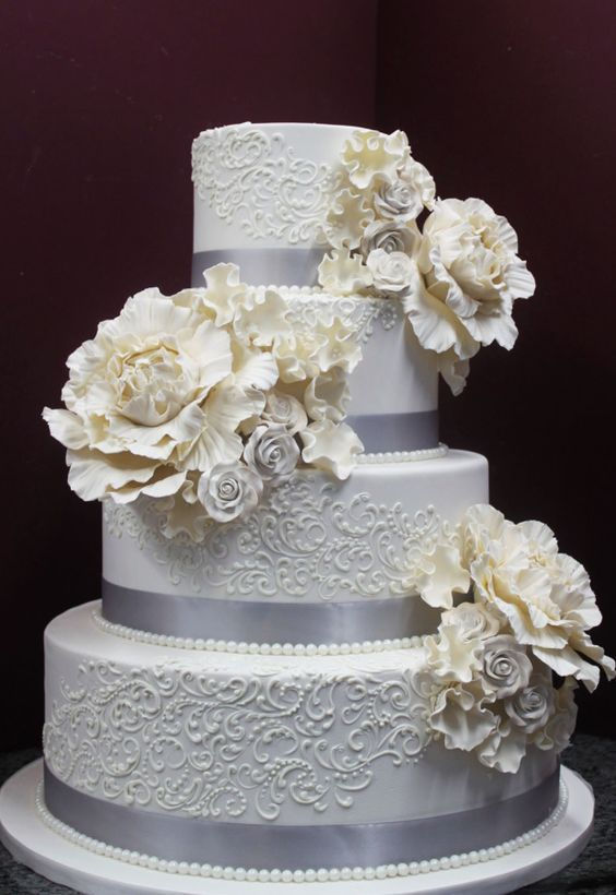 Classic silver wrapped white wedding cake; Featured Cake: Alliance Bakery