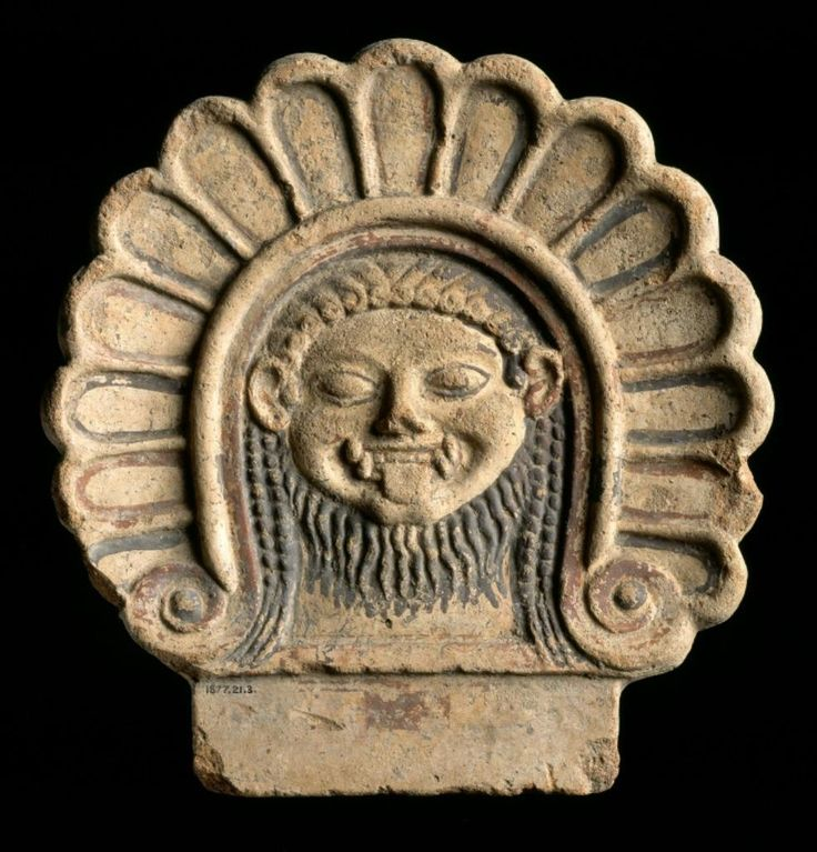 Etruscan terracotta antefix from Capua, 6th century B.C. Terracotta painted in black and red, depicting the head of a Gorgon within a border of palmettes. National Museum Scotland