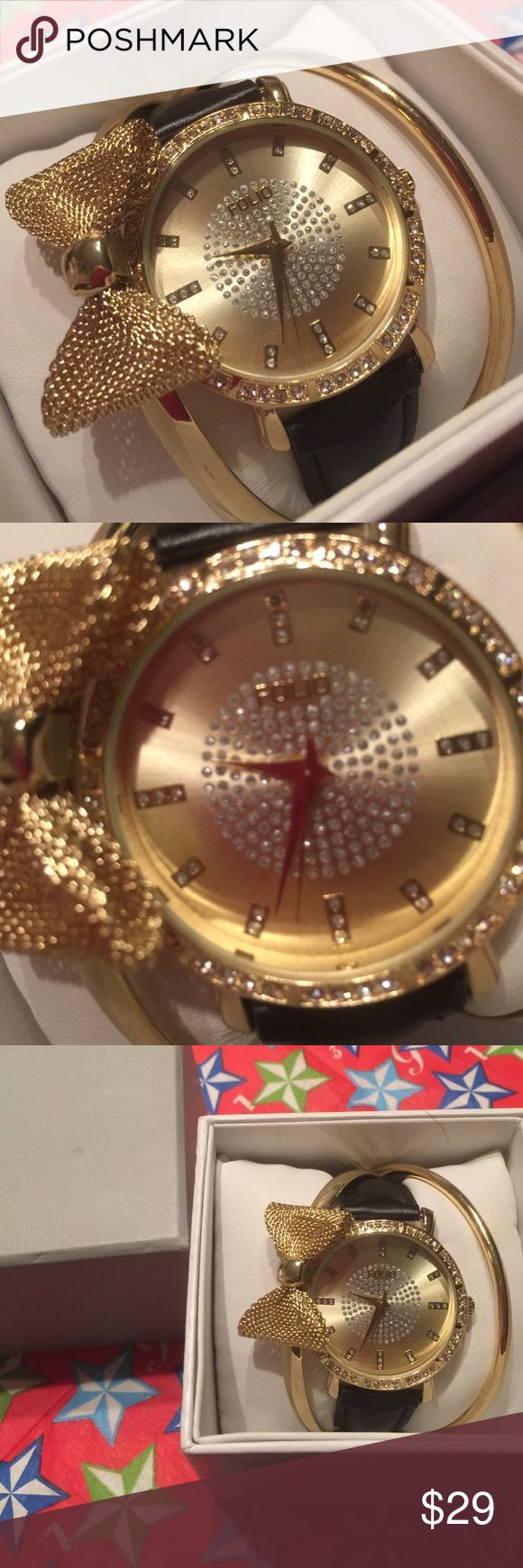 NWT 3-piece watch and bangles The watch face has stones. There are two bangles and one of them has a bow. They are all attached so I couldn't arrange them. Bundle and get $3 off. Can't be combined with other offers. Smoke free house. Accessories Watches