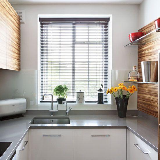 Small kitchen with veneer splashback, veneer cabinetry, grey worktops and white cupboards