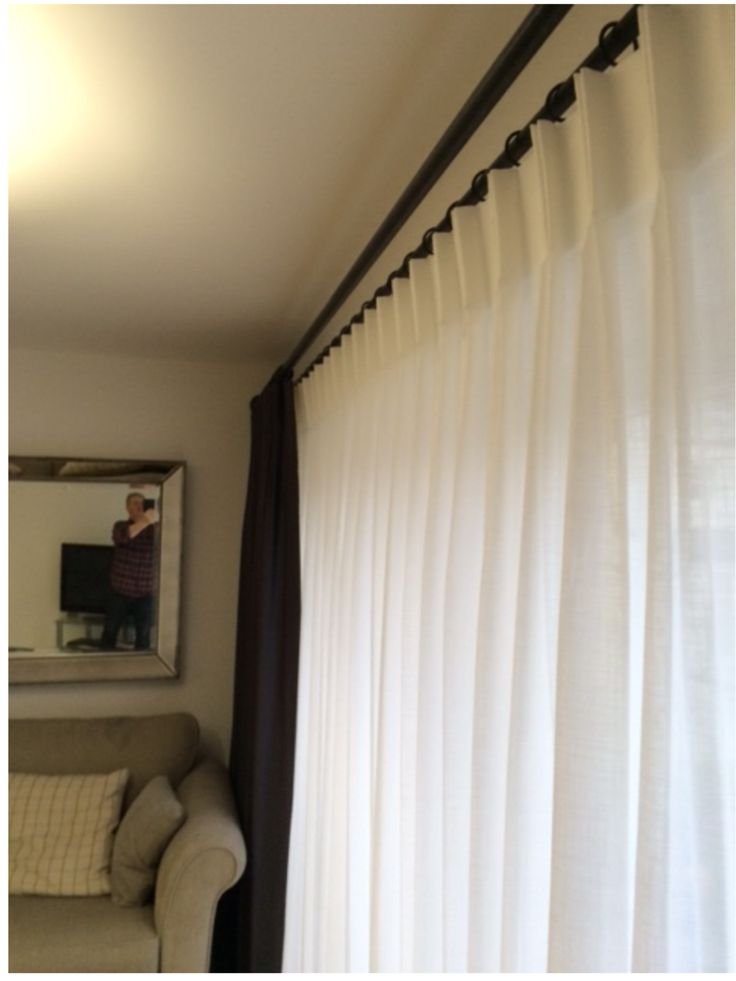Bi-fold door double curtain pole system. Allows both a sheer curtain and a heavy interlined curtain on the one double pole system. No centre bracket