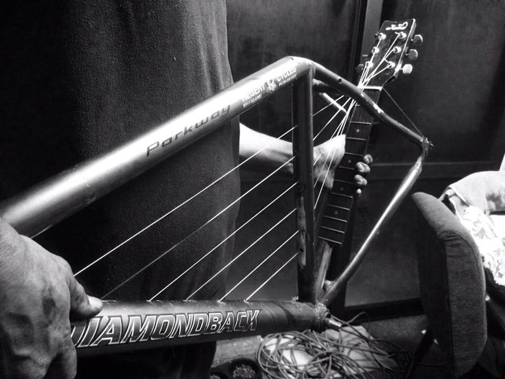 Sculpture: manipulating sound using found objects.  Title: Strings  Used: an old bicycle frame and an old guitar to recreate my interpretation of a bicycle harp guitar.