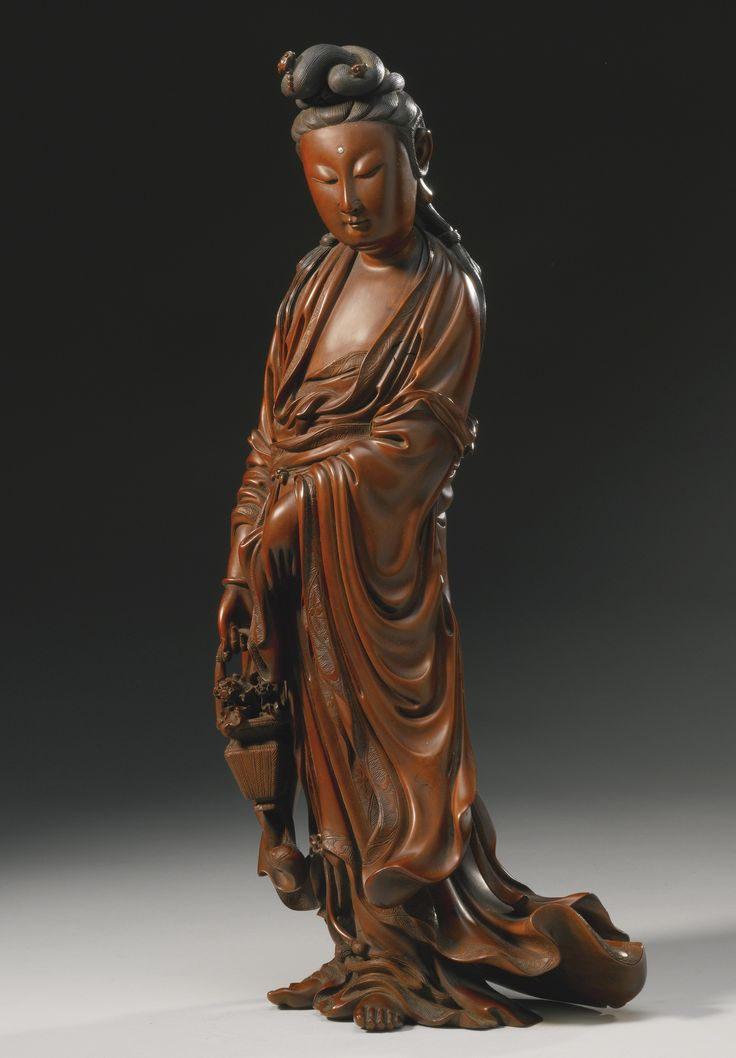 A CARVED BOXWOOD FIGURE OF GUANYIN QING DYNASTY, 19TH CENTURY.