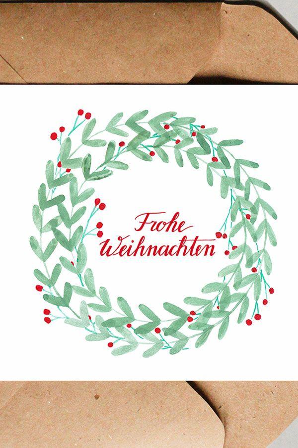 Schriftzug Frohe Weihnachten.Weihnachtskarte Mit Schriftzug Frohe Weihnachten Im Weihnachtskranz