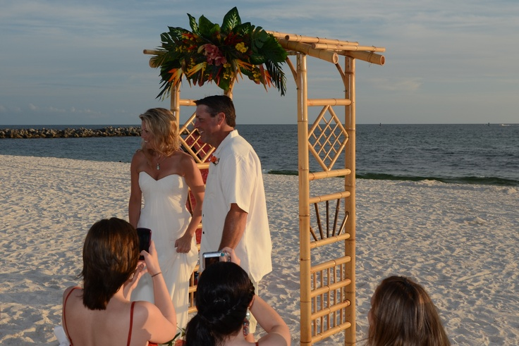 Beach Wedding - Bamboo arch with tropical flowers at a beach wedding ceremony in Panama City Beach