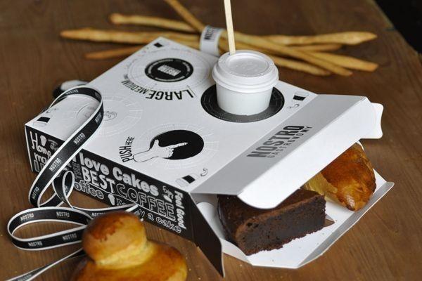 Una caja de pastelería con un sujetavasos.   31 ejemplos de que el empaquetado puede molar