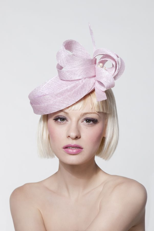 Dillon Wallwork - Powder pink sinamay pillbox trimmed with loops and swarovski/pearl brooch.