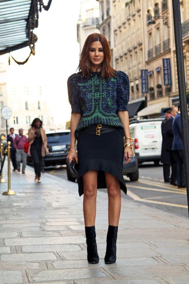 Christine Centenera wears Louis Vuitton top. Givenchy skirt. Balenciaga belt. Balmain shoes.