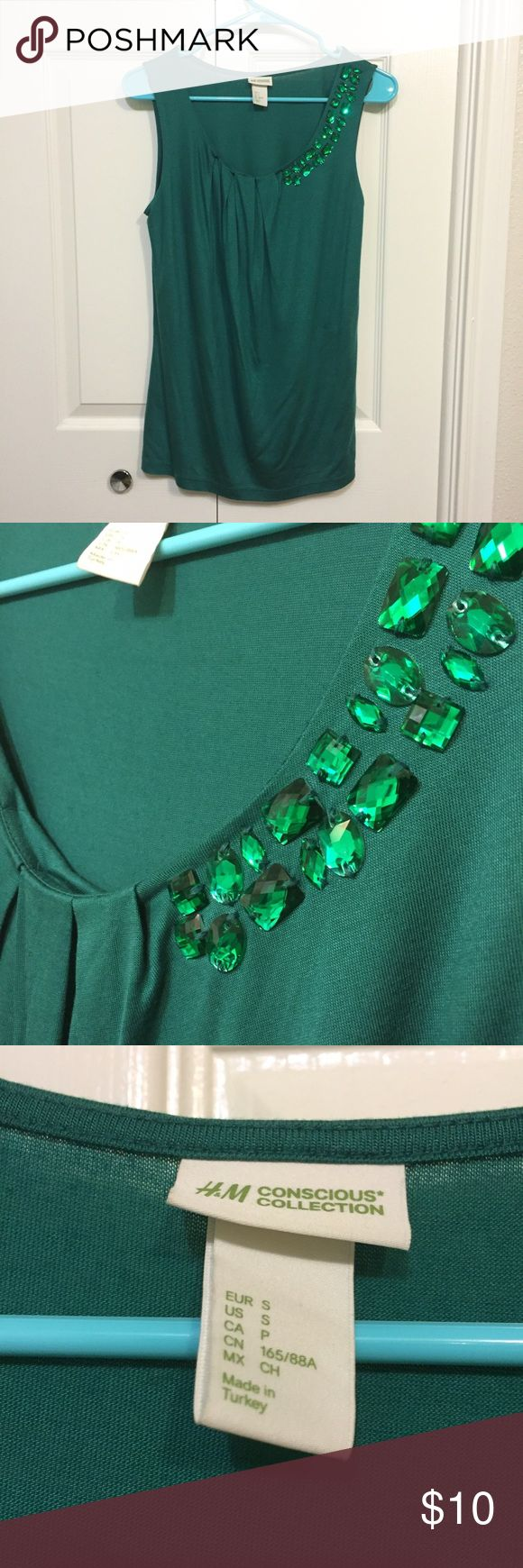 H&M Emerald Green Jewel Drape Top H&M Conscious Collection bold emerald green  top with a subtle drape is perfect for work as a shell under a blazer or cardigan. No need for a necklace as the jewels sparkle just enough for a effortless glam style suitable for the office. Wear with jeans for everyday casual-glam look too! H&M Tops Tank Tops