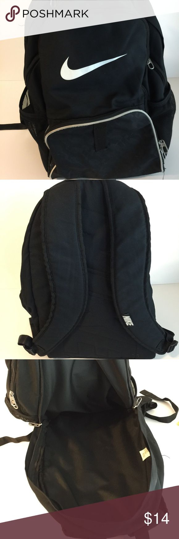 Black NIKE Backpack Black and white NIKE backpack, padded straps, handle on top, netted water bottle pockets on each side, 4 zippered compartments, good condition and clean. One small hole in the front small pocket. Smoke free home. Nike Bags Backpacks