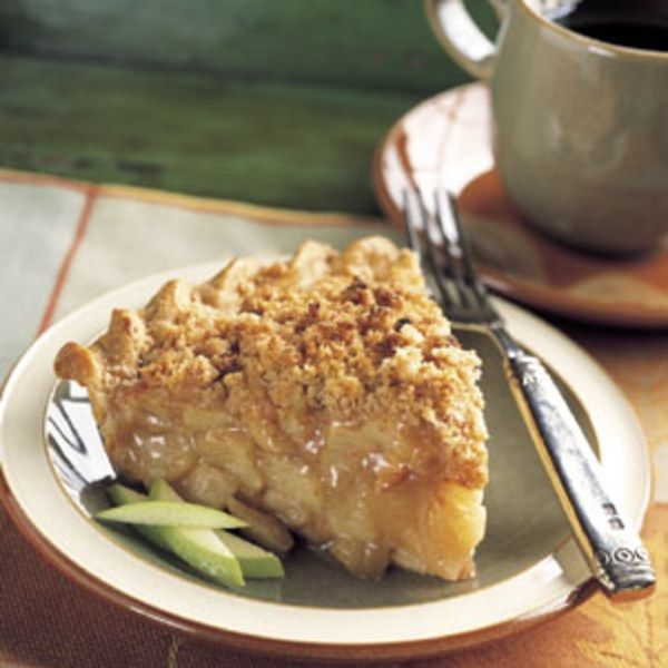 Cinnamon Crumble French Apple Pie | A thick layer of finely textured crumb topping crowns a tall mound of apple filling.