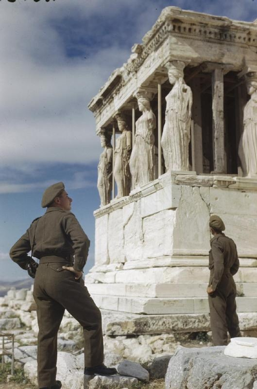 THE BRITISH ARMY IN ATHENS, GREECE, OCTOBER 1944. Sergeant R Gregory and Driver A Hardman admire the Caryatids during a tour of the Acropolis in Athens.