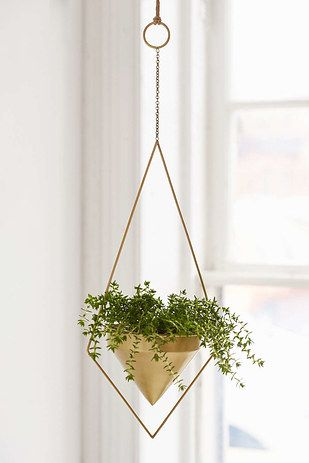 Geometric hanging planters to pop around the home for small doses of life and color. | 33 Products That Will Turn Your House Into A Minimalist Dream