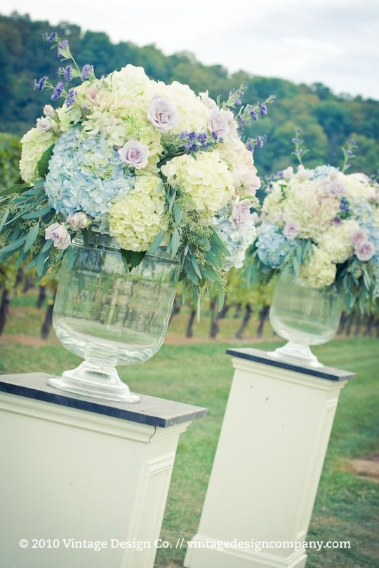 Wedding Flowers Centerpieces pastel hydrangea rose vintage shabby chic vases tall purple blue cream yellow