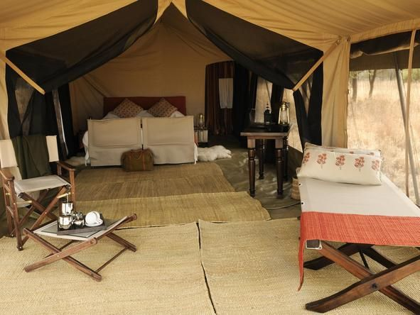 Experience an intimate tented camp that follows the wildebeest migration across the Serengeti plains at Olakira Mobile Camp in #Tanzania . #romance #beds #africa #weloveafrica