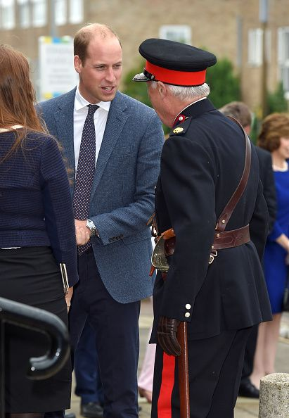 Prince William, Duke of Cambridge checks on Vice Lord Lieutenant of Essex Jonathon Douglas-Hughes after he fell over a bollard during the visit of Stewards Academy with HeadsTogether on September 16, 2016 in Harlow, England