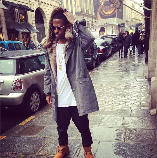 Breaking Down His Style: Big Sean Wears A $1,646 Yves Salomon Rabbit-Lined Parka, Leather Pants & Timberland Boots
