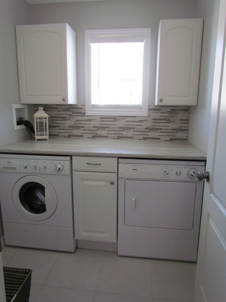 Small laundry room solutions. This has me sold - I NEED a backsplash behind the washer & dryer!