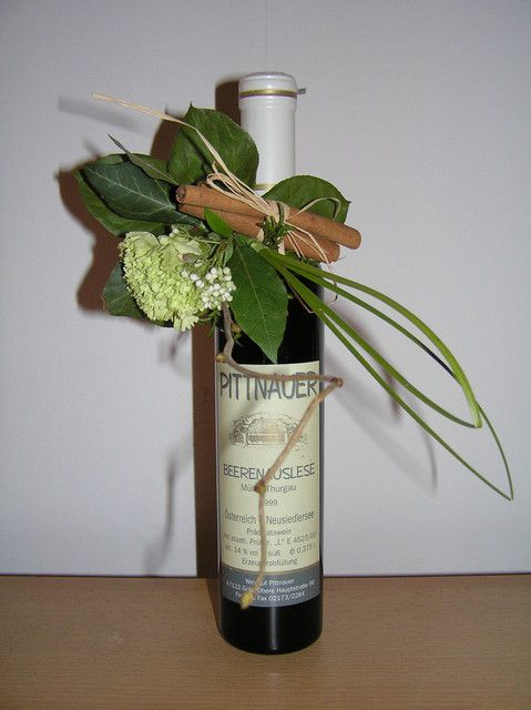 www.alfabridal.com   verjaardag cadeau, great idea, add a floral to your champagne or wine bottle at the head table!!